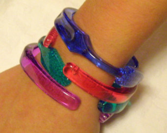 Toothbrush Bracelet: It was cool because you had to make it yourself. Also calls to mind the plastic bottle top stretch bands we made out of the caps.